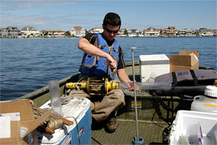 Patrick Center scientist Will Whalon prepares sediment corer in Barnegat Bay
