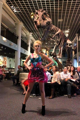 fashion model posing in front of Tyrannosaurus rex