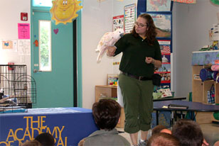 Academy teacher-naturalist holding an outreach classroom lesson