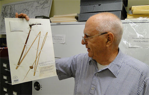 Ernie Schuyler and a herbarium sheet containing a speciment of the delta bulrush