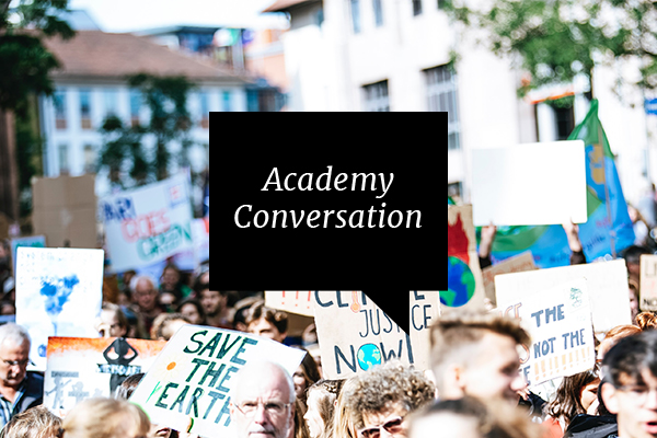 academy conversation protestors with environmental signs