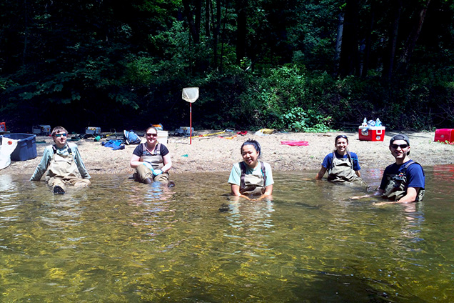 academy scientists in creek
