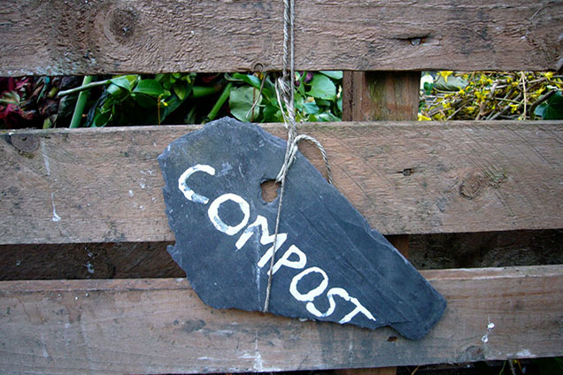 compost sign on wood fence