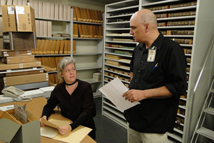 Academy archivist and a library volunteer discuss the work agenda