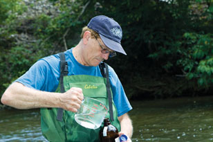 environmental chemist Paul Kiry taking water quality samples