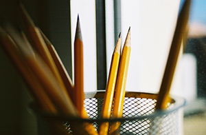 Sharpened pencils in a cup