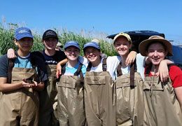 Students in their waders at Drexel's Environmental Science Leadership Academy 2015