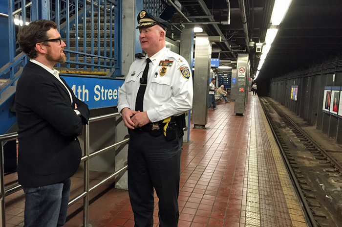 Drexel University Faculty Jordan McClain talking with a police officer about body cameras