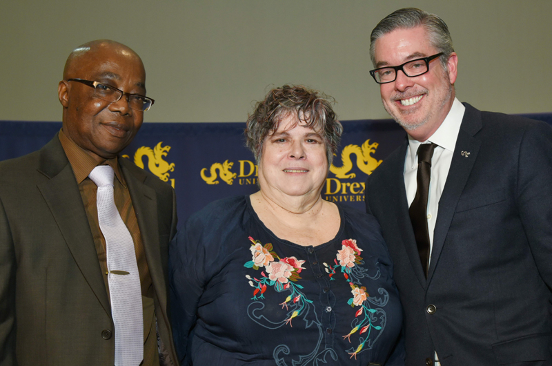 Miriam Kotzin, at center, with Drexel President John Fry, right, and Abisoeh Porter, PhD, left, head of the Department of English & Philosophy.