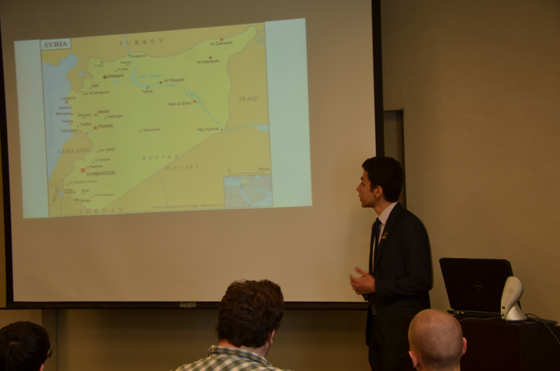 Mahmoud Hallak during his presentation on the unrest in Syria.